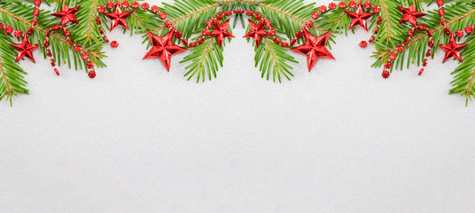 Fir tree branches and star shaped Christmas ornaments