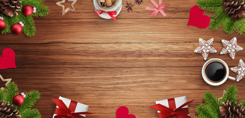 Christmas decoration, gift, cup of coffee and gingerbread cookies on wooden table. Empty space for text input