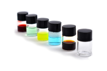 Laboratory glassware stock images. Vial on a white background. Ampoules with color specimen