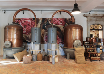 Ancient distiller for the production of perfume in Fragonard factory in Grasse, France