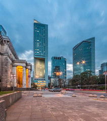 Warsaw, capital of Poland, modern skyscrapers on Emilii Plater street in the evening