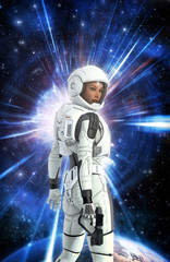 Wall Mural - futuristic astronaut girl in space suit and planet