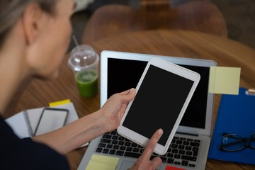 Cropped image of businesswoman using tablet