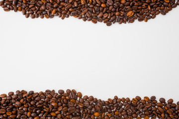 A scattering of coffee beans are located on opposite sides of the photo. The background is white, light, closeup. Direction - cafes, bars,pizzerias.