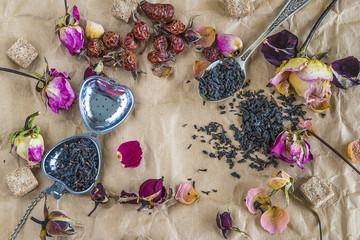 tea ceremony/dry tea, dry rose flowers on crumpled paper background