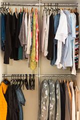 Wardrobe order. Capsule closet. Woman. Clothes.