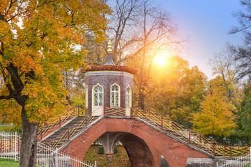 beautiful autumn landscape with Krestovy Bridge and the sunset sun in the suburb of St. Petersburg Pushkin, Russia