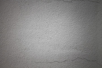 Gray wall surface, bright white in the middle. Backgrounds and Wallpapers