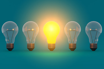 Idea concept glowing bulb on blue green background