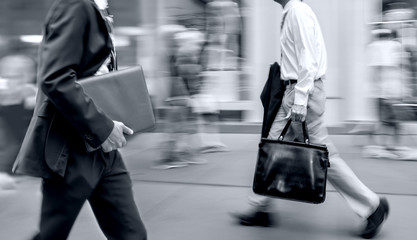 group of business people in the street in monochrome blue tonality