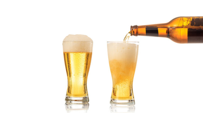 Pouring beer in a glass on white background