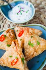 Indian Spicy Vegetable samosa with Mint Yoghurt Raita.