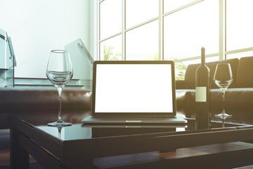 Blank laptop screen in office toned