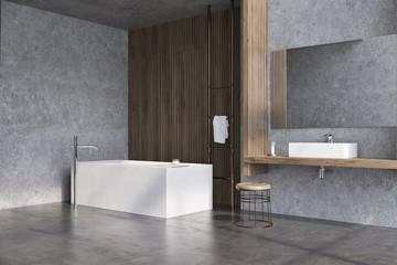Gray and dark wooden bathroom, tub side