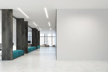 White and wooden open space office, blue sofas