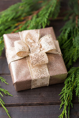 Christmas gift on the antique wooden background.