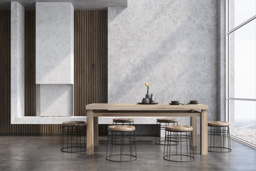 Concrete dining room interior, fireplace
