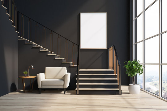 Black living room, stairs, armchair, poster