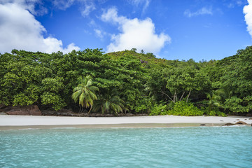 Looking to the coast of anse lazio from the water, praslin, seychelles 4