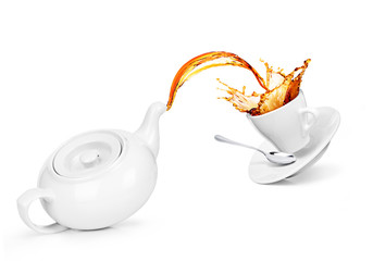Concept kettle with a cup. Tea is poured into a cup, isolated on a white background