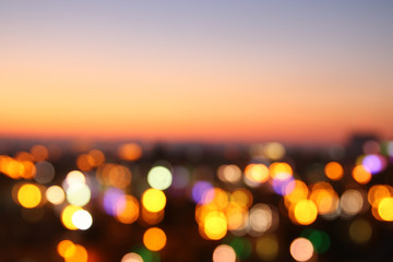 abstract image of blurred night city background with circle lights.