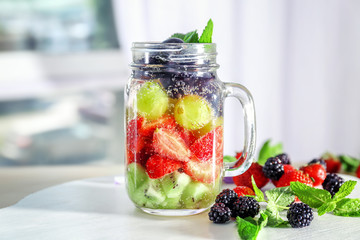 Mason jar of berry infused water on table