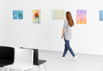 Young woman in art gallery