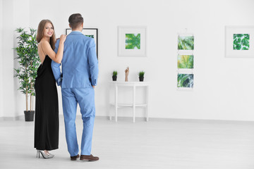 Couple in formal wear at art gallery exhibition