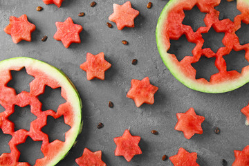 Stars made of watermelon on color background
