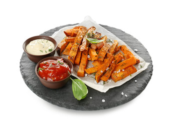 Slate plate with cooked sweet potato on white background