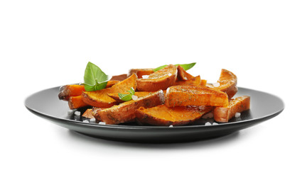 Plate with cooked sweet potato on white background