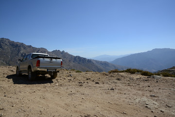 parked off-road car on a mountain plateau, Corsica