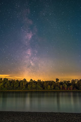 The Galactic Center as seen from the shore of the river Rhine at Mannheim in Germany.
