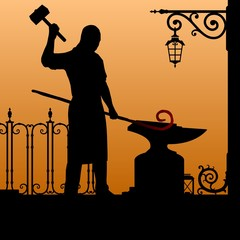 Silhouette of the smith. Blacksmith in the smithy. The smith forges iron.