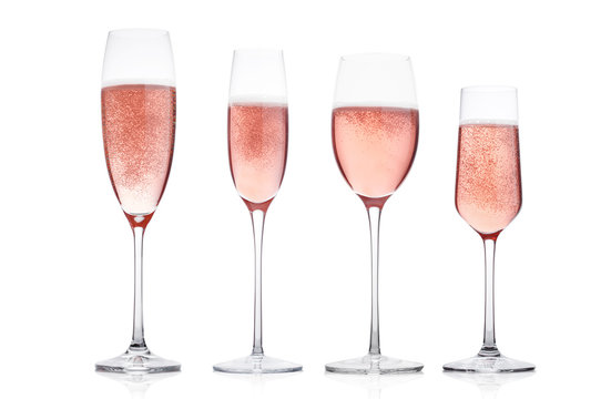 Champagne rose glasses with bubbles on white