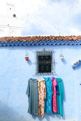 Handicrafts displayed for sale on the streets of Chaouen, Morocco.