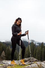 Girl hikes along Lake Obernberg in the mountains of Austria