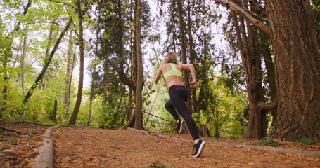 Runner Woman running In Woods Exercising Outdoors sprint