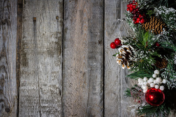 Christmas decorations on barn wood