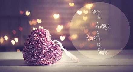 There Is Always A Reason To Smile message with a pink heart with heart shaped lights