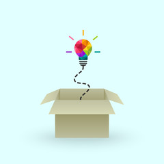 Think outside the box and creativity concept with colorful lightbulb and cardboard box