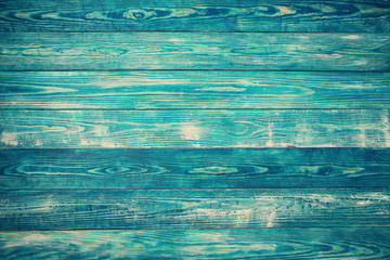 Old wooden planks. Blue background with painted boards