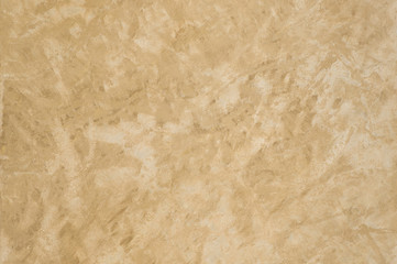 background of the plastered texture with marble effect gold color. artistic background handmade