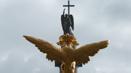 Sculpture of golden two-headed eagle and the angel on the Alexander Column on the Palace Square - St Petersburg, Russia