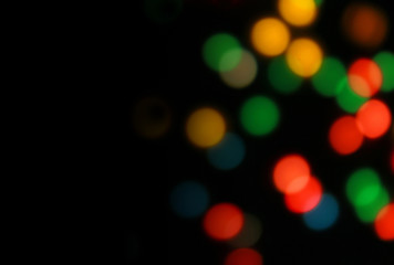 Black background with blurred multicolored lights with place for text