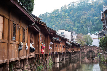Traditional wooden buildings and ancient stone bridge in Fenghuang Ancient Town, Hunan Province, China