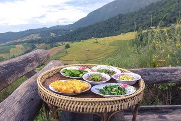 Thai traditional food set (Kantoke) at Bongpieng forest, Chiangmai, Thailand.