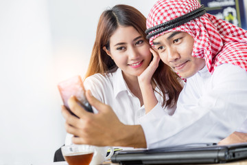 business arabian man selfie with asian business woman
