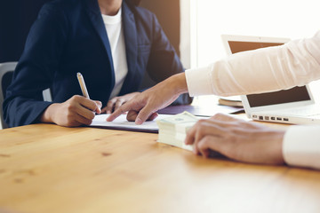The customer sign a housing loan agreement.