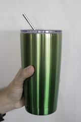 Hand holding coffee reuse glass